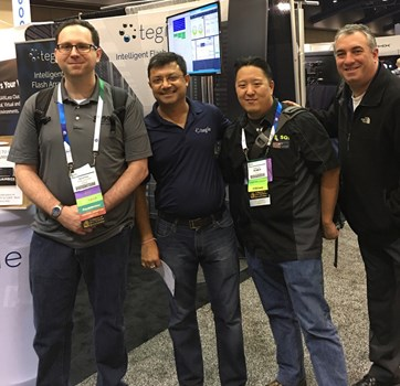 group-photo-in-front-of-tegile-booth-even-acosta